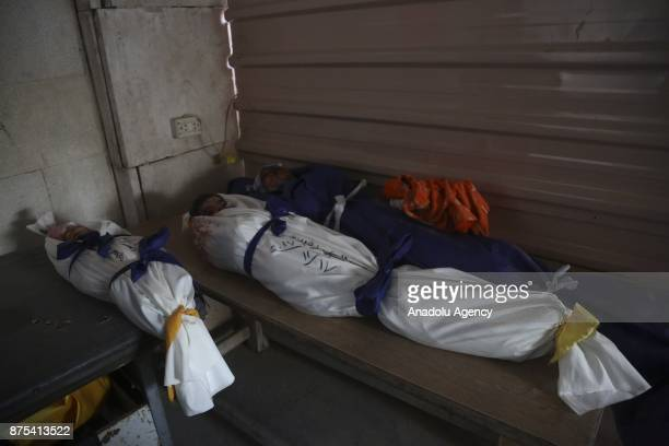 Dead bodies of children are seen after Assad regime's war crafts carry out intensifying airstrikes over residential areas of Douma town of the...