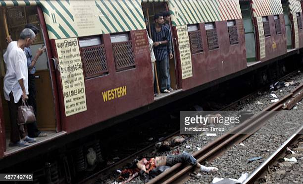 Image depicts death MUMBAI INDIA JULY 11 Dead bodies of passengers after a railway train compartment hit by Tuesday's bomb blast at Mahim railway...
