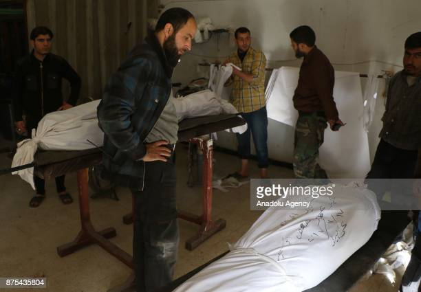 Dead bodies of people are seen after Assad regime's war crafts carry out intensifying airstrikes over residential areas of Arbin town of the Eastern...