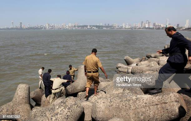A dead body came floating near the shores at Marine Drive local policemen and fire brigade officials try to fish the body out