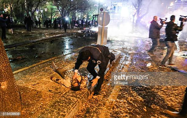 A dead body lies at the explosion site on March 13 2016 in Ankara Turkey At least 27 people were killed and 75 wounded in an explosion in the Turkish...