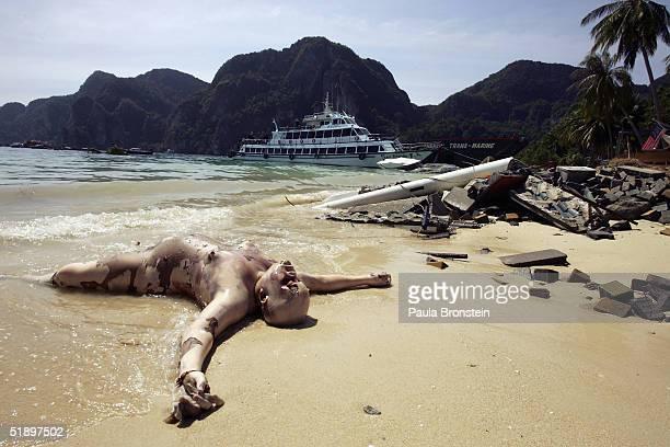 A dead body lies on the beach December 28 2004 on Phi Phi Village on Ton Sai Bay Thailand On Phi Phi Island hundreds were killed when an earthquake...