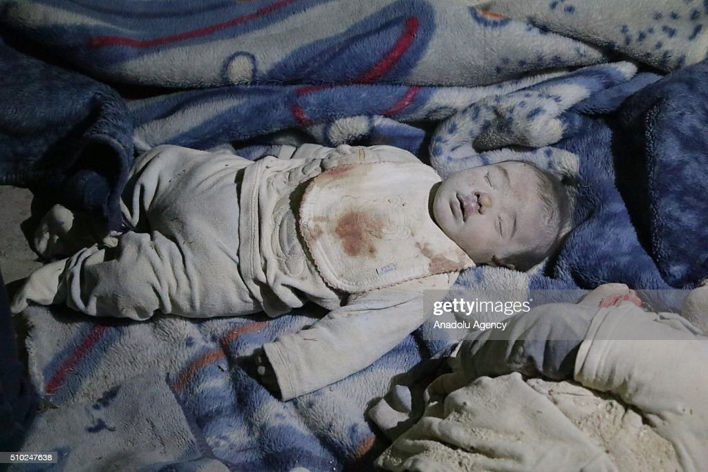 Dead body of 3-month-old baby Hamza Abdullah is seen after the Russian airstrikes targeted residential areas in opposition controlled Katranci neighborhood of Aleppo, Syria on February 14, 2016.