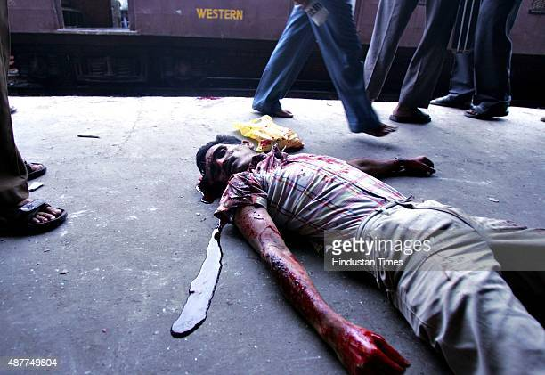 Image depicts death MUMBAI INDIA JULY 11 Dead body of a passenger after a railway train compartment hit by Tuesday's bomb blast at Mahim railway...