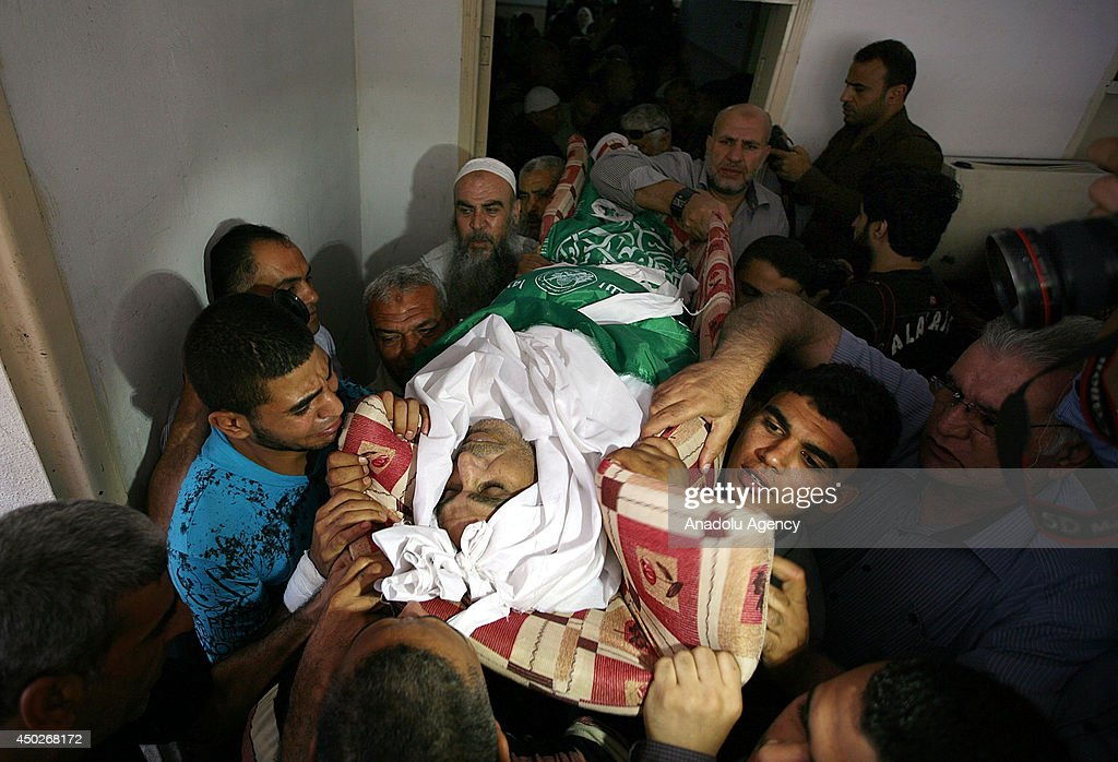 Dead body of Palestinian fisher Imad Salim (52), shot by Israeli soldiers two weeks ago and died on June 8, 2014 at the hospital, is being carried by his relatives during the funeral ceremony in Gaza City, Gaza.