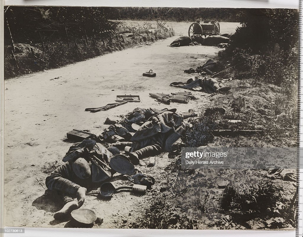 'Dead British and ruined transport' France WWI 1916 Dead soldiers lying on a roadside in northern France probably during the Battle of the Somme In...