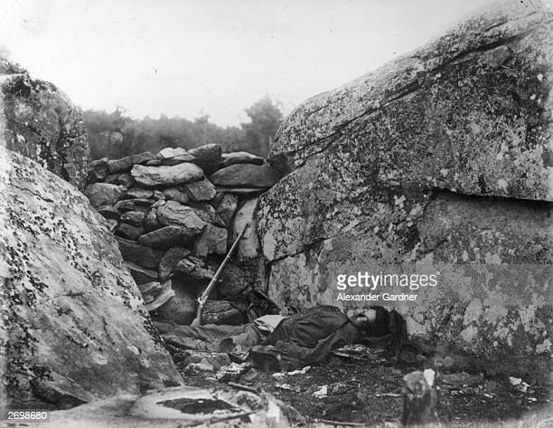 A dead Confederate soldier in Devil's Den Gettysburg Photograph entitled 'The Home of a Rebel Sharpshooter Gettysburg' from 'Gardner's 'Photographic...