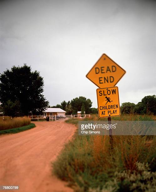 Dead end, slow, children at play road signs
