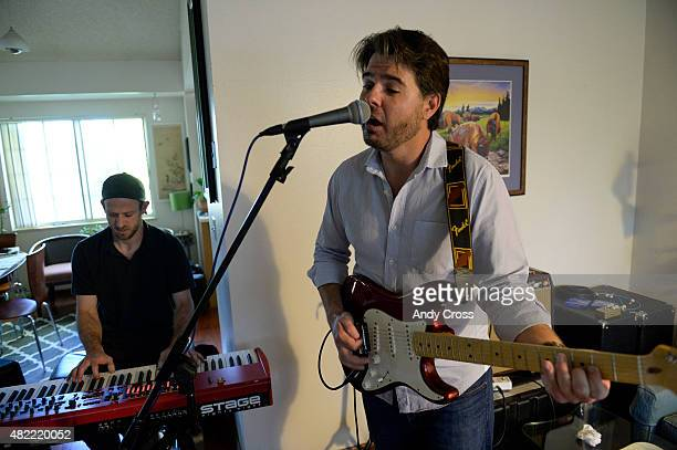 Dead Floyd band members Matt Goldberg on keyboards and Charlie Humphreys on guitar practice in Charlie's living room July 23 2015