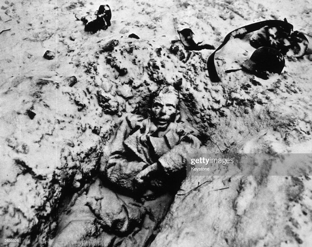 Dead German soldiers on a roadside in France in July 1944