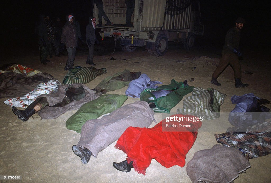 Dead Iraqi soldiers are gathered together after their convoy was destroyed by coalition bombing during the Persian Gulf War In August of 1990 Iraqi...