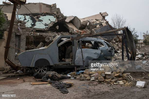 Image contains graphic content A dead Islamic State militant beside the suicide car bomb he failed to detonate in Hay Tayran west Mosul March 18 2017...