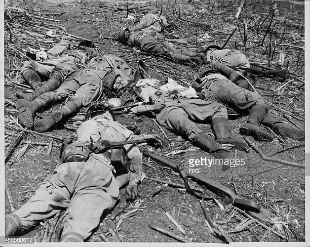 Dead Japanese soldiers following the US assault on Tinian during the Pacific Campaign of World War Two Papua New Guinea Northern Mariana Islands June...