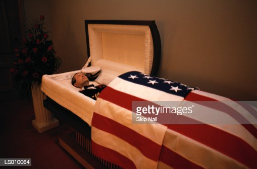 Dead Man in a Coffin Draped with the American Flag : Stock Photo