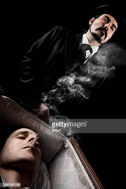 Dead man smoking in the coffin