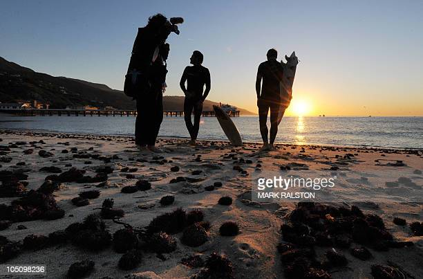 Dead sea urchins litter the beach which was closed to swimmers due to contaminated water from recent rain runoff before the dedication ceremony for...
