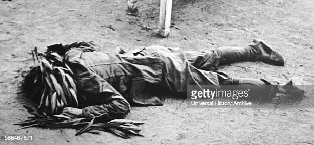 Dead soldier lies in the streets of Cataluña during the Spanish Civil War