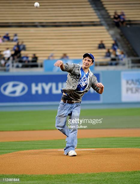 'Deadliest Catch' crew member Jake Harris throws out the ceremonial first pitch before The Los Angeles Dodgers game at Dodger Stadium on April 18...