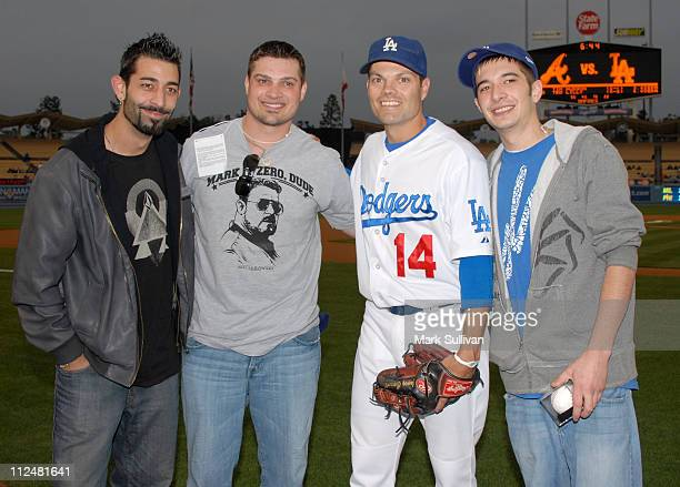 'Deadliest Catch' crew members Josh Harris Ryan Simpson and Jake Harris on the field with Dodger player Jamey Carroll before The Los Angeles Dodgers...