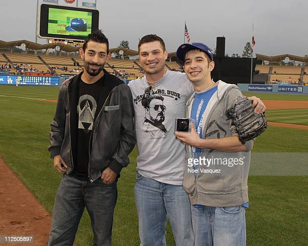 Deadliest Catch crew members Josh Harris Ryan Simpson and Jake Harris attend a game between the Los Angeles Dodger and Atlanta Braves on April 18...