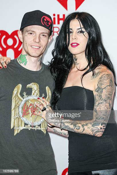 Deadmau5 and television personality Kat Von D arrive at iHeartRadio Music Festival press room at MGM Grand Garden Arena on September 22 2012 in Las...