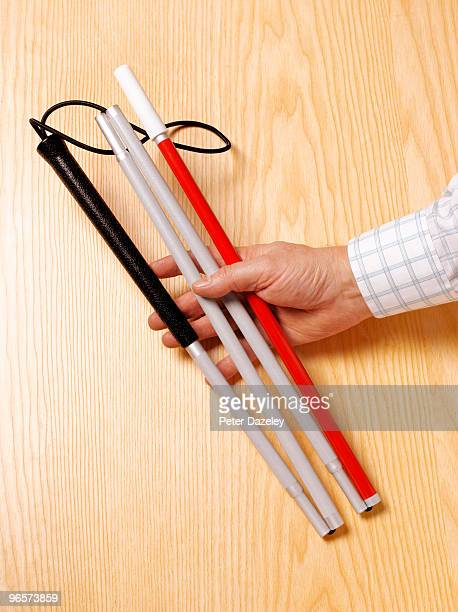Deaf and blind man with white cane