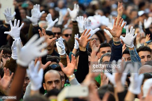 Deaf people raise their hands to applaud the speaker during a demonstration to ask for the recognition of the signed language on November 20 2014 in...