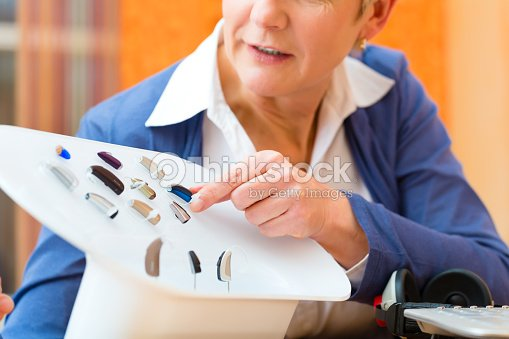 Deaf Woman Makes A Hearing Test Stock Photo | Thinkstock