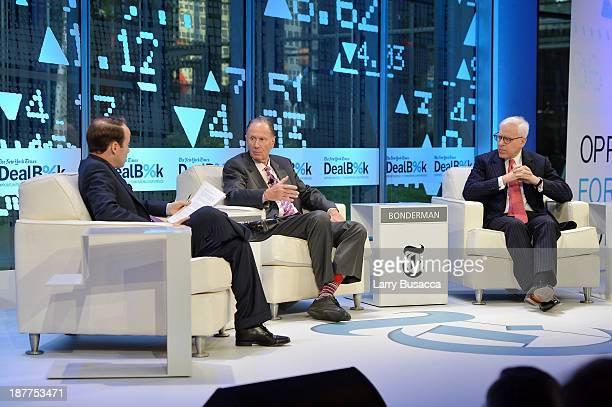 DealBook reporter Peter Lattman founding partner at TPG Capital David Bonderman and Carlyle Group cofounder David Rubenstein participate in a...