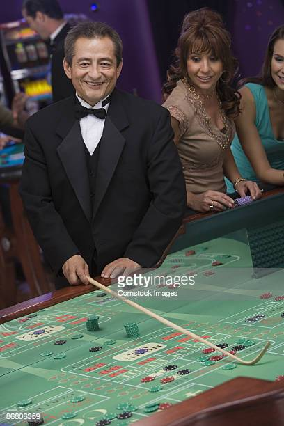 Dealer at craps table and woman