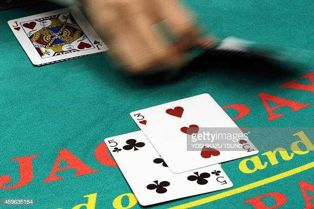 A dealer demonstrates how to play blackjack at a leisure exhibition in Tokyo on November 27 2014 The Japanese government gave up to pass a bill to...