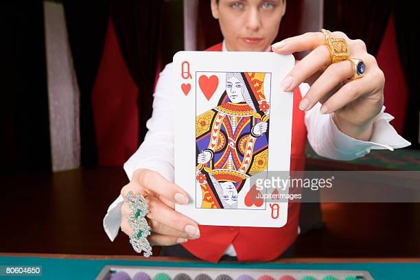 Dealer holding queen of hearts