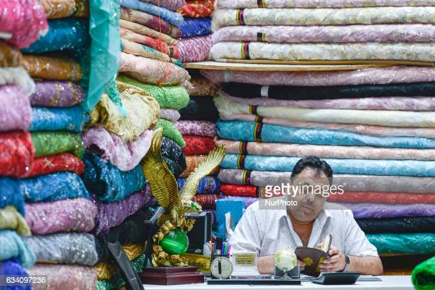 A dealer inside a shop with fabrics and textils in Dubai Old Town On Monday 6 February in Dubai UAE