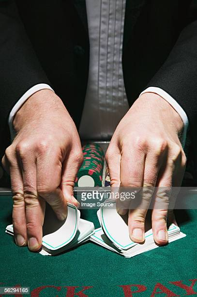 Dealer shuffling cards