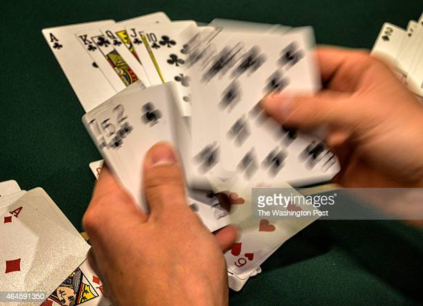 A dealer sorts his deck during a break in the Poker tournament at the Horseshoe casino on February 2015 in Baltimore MD