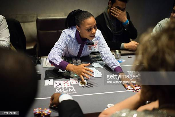Dealer Stacie Bradford deals the very first poker game at the casino The MGM Casino in the National Harbor opened to the public on Thursday night...