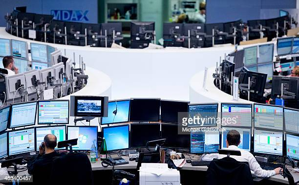Dealer work on the trading floor of Deutsche Boerse AG on November 2 2013 in Frankfurt Germany Investigators have searched offices of Commerzbank in...