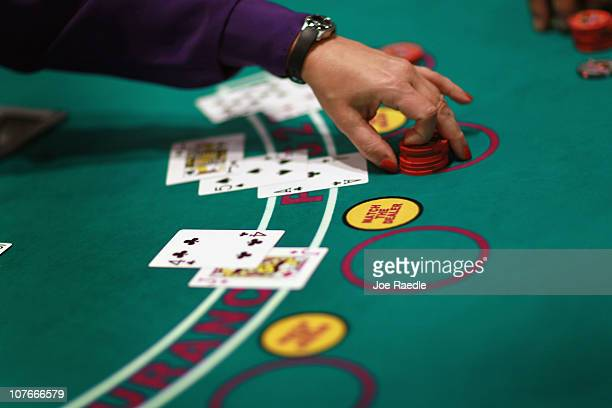 A dealer works the blackjack table during the grand opening of the newest building at the Seminole Casino Coconut Creek on December 17 2010 in...