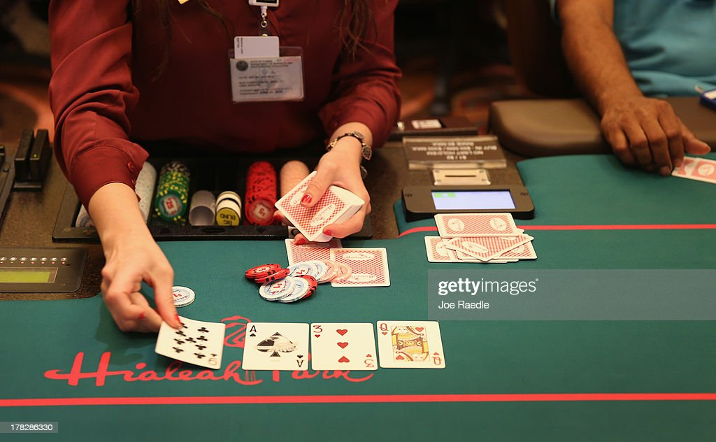 A dealer works the Blackjack table for customers in the casino that will hold its grand opening on Friday located in the Hialeah Park Race Track which first opened in 1925 on August 28, 2013 in Hialeah, Florida. The new casino is located in the same complex as the race track which in its heyday was known as the 'the worlds most beautiful race course.'