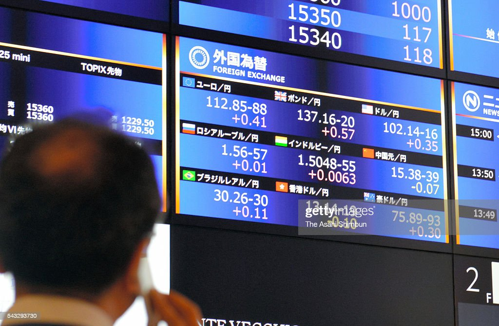 A dealer works with watching an electric board displaying the foreign exchange rate at the Osaka Exchange on June 27, 2016 in Osaka, Japan. Japanese government and the central bank held a meeting to measure the impact of the 'Brexit'.