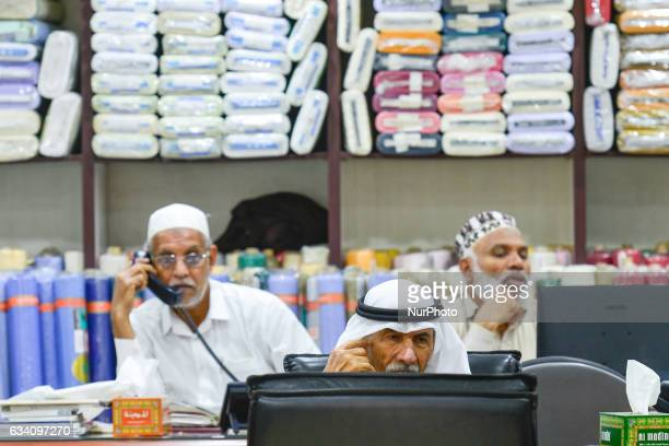 Dealers inside a shop with textiles a scene from the market in Dubai Old Town On Monday 6 February in Dubai UAE