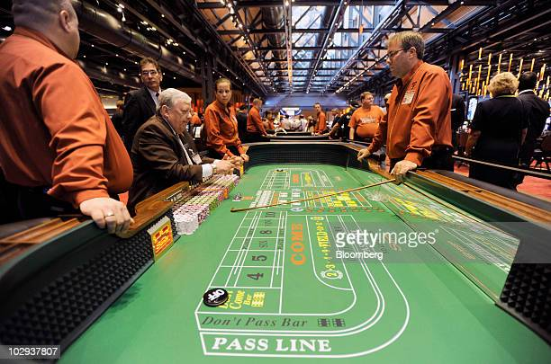 Dealers ready the craps table for a game at the Sands Casino Resort in Bethlehem Pennsylvania US on Friday July 16 2010 Three casinos in Eastern...