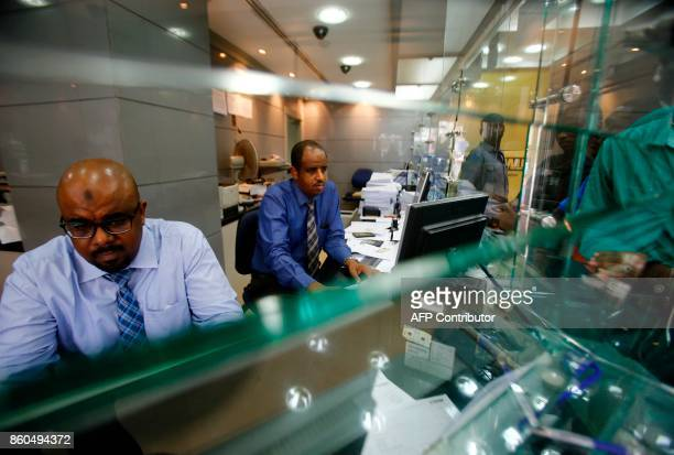 Dealers work at a foreign exchange office in central Khartoum on October 12 after the lifting of the US trade embargo came into effect Sudan's...