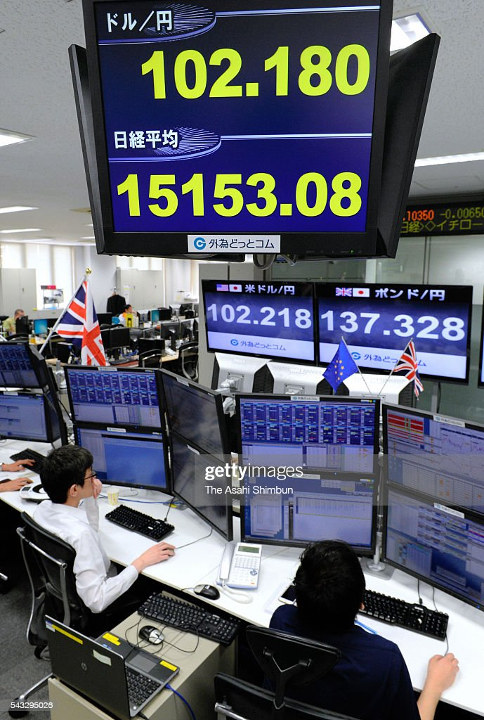 Dealers work under an electric board displaying the foreign exchange rate at the Gaiteme.com on June 27, 2016 in Tokyo, Japan. Japanese government and the central bank held a meeting to measure the impact of the 'Brexit'.