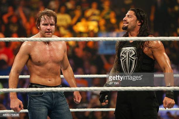 Dean Ambrose and Roman Reigns celebrate their victory at the WWE SummerSlam 2015 at Barclays Center of Brooklyn on August 23 2015 in New York City