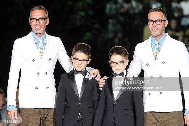 Dean and Dan Caten walk the runway during the DSquared2 show as part of Milan Fashion Week S/S 2014 on June 25 2013 in Milan Italy