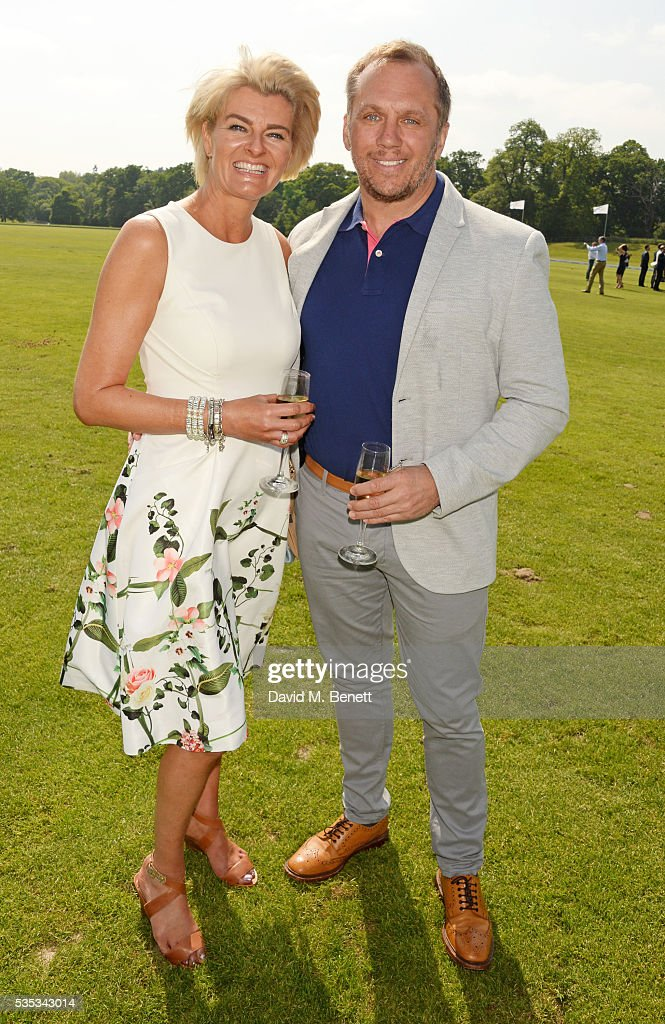 Dean Andrews (R) and Helen Bowen-Green attend day two of the Audi Polo Challenge at Coworth Park on May 29, 2016 in London, England.