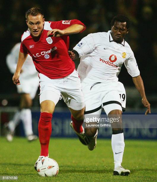 Dean Ashton of Crewe battles with Eric DjembaDjemba of Manchester United during the Carling Cup Third Round match between Crewe Alexandra and...