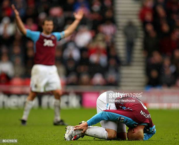 Dean Ashton of West Ham holds his ankle after being tackled during the Barclay's Premier League match between Sunderland and West Ham United at the...