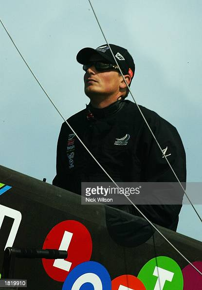 Dean Barker of Team New Zealand watches the crew work to cut away their rig after they broke their mast during Race Four of the America's Cup between...